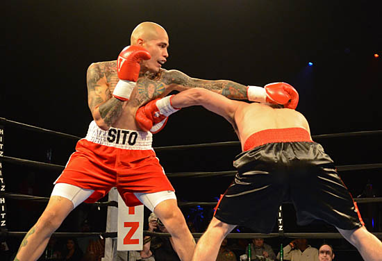 Ricky Smith (R) lands a shot to the body under Luis Santiago's jab