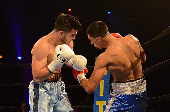 Navarro (L) looks for a counter as Ramirez (R) attacks