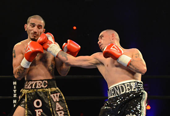 Mendez (R) gets under Canas's guard