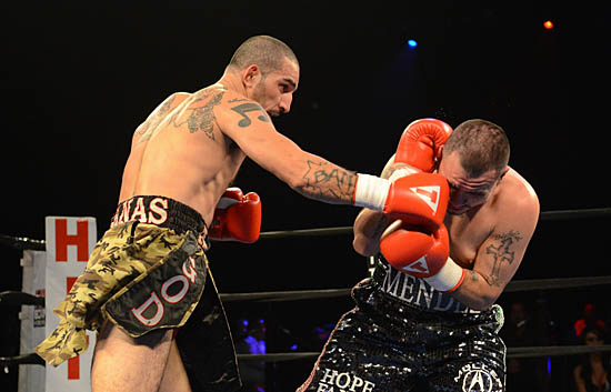 Antonio Canas (L) finds an opening as Genaro Mendez tries to cover