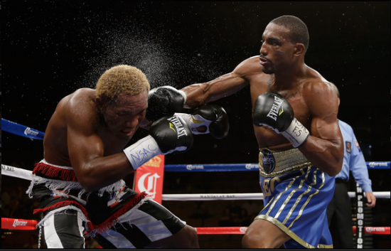 J'Leon Love, at right, in action (photo courtesy of www.mayweatherpromotions.com)