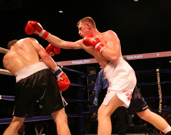 Andrzej Fonfara, at right, attacks with his right on Karpency last November (photo by Belle Ayllon)