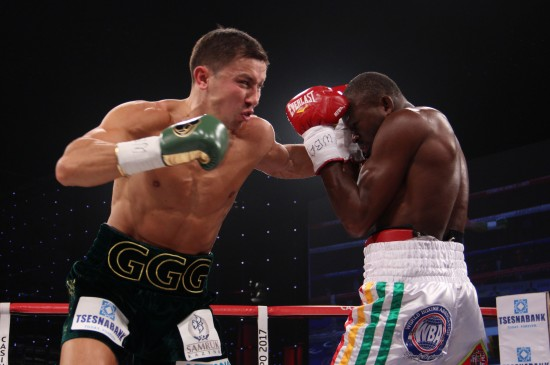 Golovkin, at left, lands a smashing left hook to the face of Adama