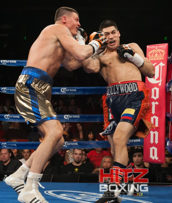 Jimenez, at right, catches Campbell with a compact uppercut.