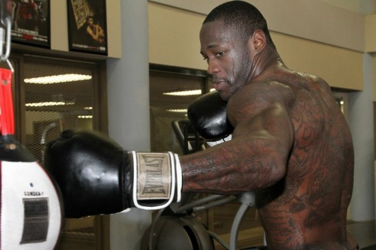 Deontay Wilder hits the heavyweight bag.