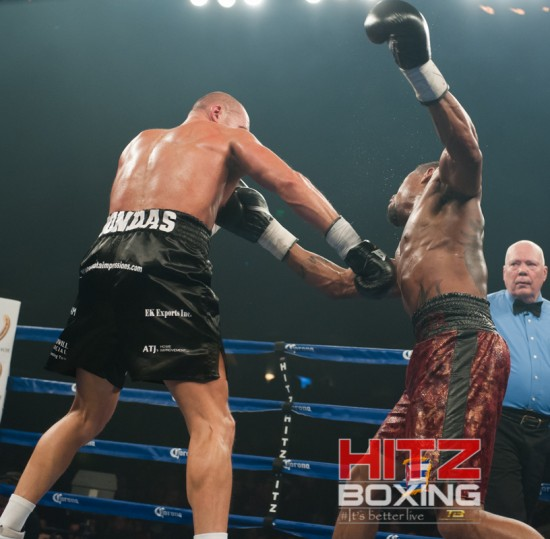 Bondaravas, at left, nails Monroe as referee Bill Paige looks on.