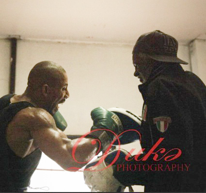 Adolph Pruitt (right) working the mitts at the Long Beach Boxing & Fitness Gym.
