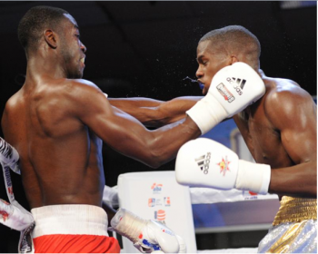 (L) - Marlo Delgado nails Yaciel Despaigne - Photo by Emily Harney