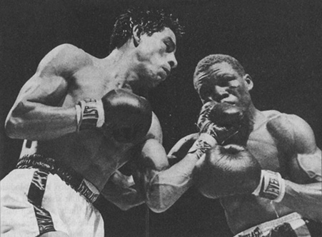 Gaspar Ortega (left),  lands a left uppercut to the jaw of Benny (Kid) Paret during their August 7, 1959 scrap in Madison Square Garden, which Ortega won over 10 rounds.