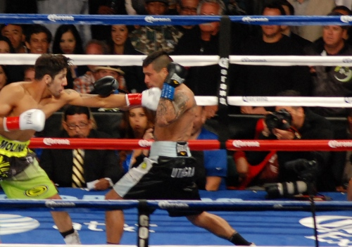 John Molina (Left) tries to hold hard charging Lucas Matthysse off with a jab.