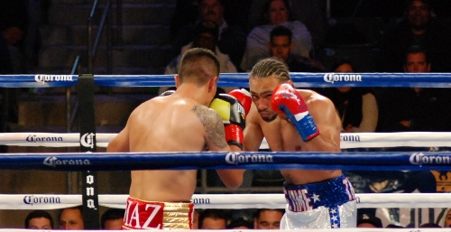 Keith Thurman (right) and Julio Diaz size each other up.