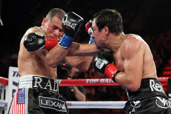 Marquez, at right, drills Alvarado with a crisp right to the chin (photo by Chris Farina - Top Rank, Copyright 2014)