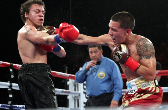 Featherweight  Óscar Valdez of Mexico, at right, stops  Noel Echevarria, Puerto Rico, in the 7th round to remain undefeated (photo by Chris Farina - Top Rank, Copyright 2014)