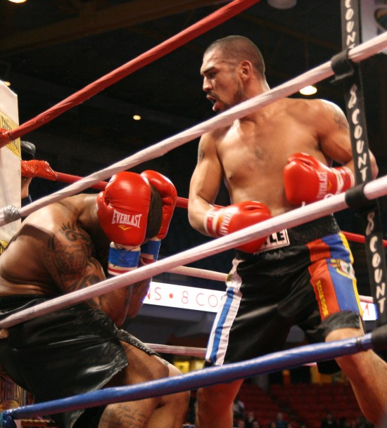 Dimar Ortuz, at right, en route to stopping Francois Russell several years ago (photo by Juan C. Ayllon)