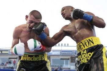 Devon Alexander catches Karass with a sharp right uppercut to the face (photo courtesy of   )