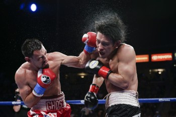 Guerreo, at left, lands a crunching left to the head of Kamegai (photo courtesy of