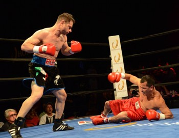 Russell Fiore (L) enjoys the first knockdown of his bout against Tim Carrizale
