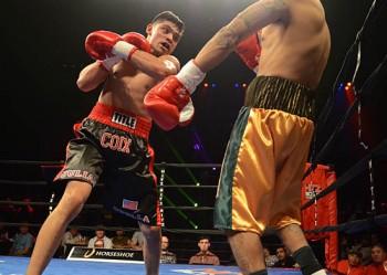 Coix (L) drives forward against Thomas Amaro