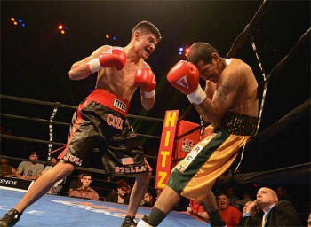 Coix (L) pelts Amaro with a hail of punches near the end of the bout