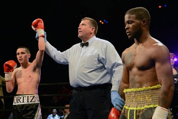 Adan Ortiz enjoys his stoppage victory over the disappointed Antoine Knight