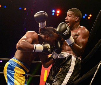 Nick Asberry (R) finds himself pinned against the ropes by the hard-charging James Shorter