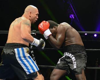 Dimar Ortuz (L) takes control against Daniel Adotey Allotey