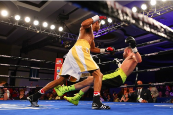 Dargan Knocks Flores Down - Photo by Rich Graessle/ Main Events