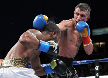 Lomachenko, at right, bounces a left off the head of Russell (photo courtesy of Chris Farina - Top Rank, Copyright 2014)