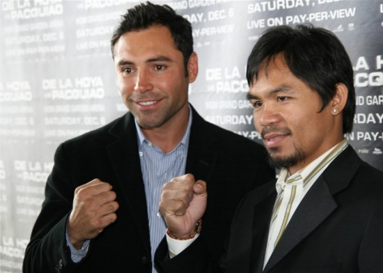 Oscar De La Hoya, seen here at left with Manny Pacquiao several years ago, addresses some changes at Golden Boy Promotions (photo by Juan C. Ayllon)