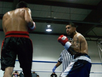 Rojas, at right, stalks his opponent.