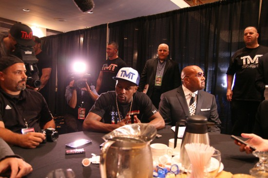 As cameras record, Mayweather addresses the print media table at the Congress Plaza Hotel on Tuesday, July 15, 2014.