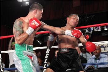 """Bryant """"PeeWee"""" Cruz (L) smashes  Jose Morales"""