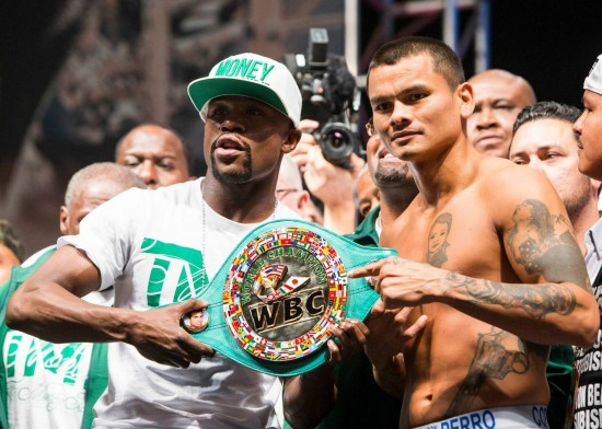 Mayweather, at left, and Maidana at their weigh-in for tonight's rematch.