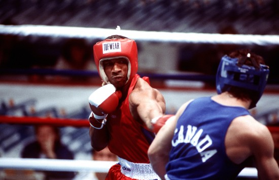 Ron Simms, at left, seen fighting his first match of the Pan American Games in 1995 against Canadian Peter Pestowka -- a bout that he reportedly won easily (http://www.defenseimagery.mil)