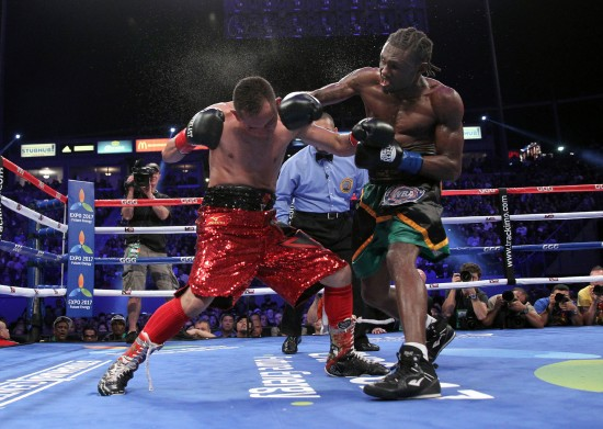 Walters, at right, lands the knockout blow (photo by Chris Farina-Top Rank, Copyright 2014).