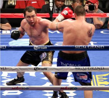 (L) Beibut Shumenov sets up his power punch with a stiff jab against Bobby Thomas Jr. - Photo by Ed de la Vega)