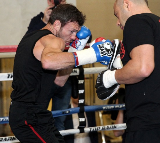 Andy Lee, shown here doing mitt drills (photo by Chris Farina-Top Rank, Copyright 2014)