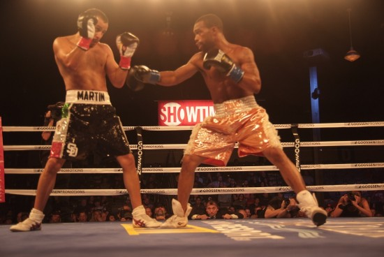 Russell, at right, works his way in against Martin.