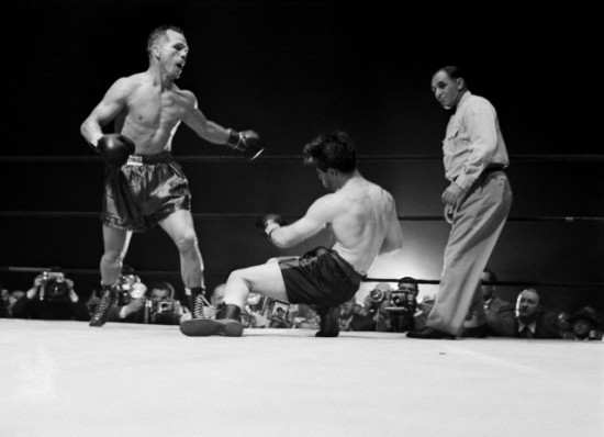 Tony Zale, shown here dropping Rocky Graziano in one of their epic wars (photo courtesy of www.boxrec.com)