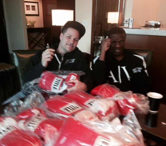 """Ice"" John Scully and Floyd Mayweather, Sr. sign boxing gloves."