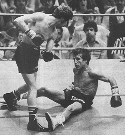 Danny Lopez (left) dropping Jose Torres enroute to a 7th round stoppage in his September 13, 1977 featherweight title defense.