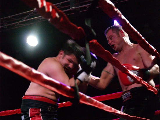 Uhde, at right, counters with an uppercut.