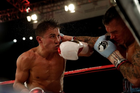 Golovkin, at left, batters Murray in close (photo courtesy of Will Hart/HBO).