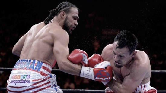 Thurman, at left, lands a crunching right to the head of Robert Guerrero (photo courtesy www.premierboxingchampions.com)