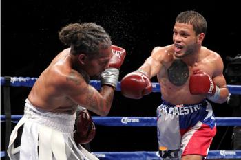Reynaldo Ojeda (R) out-boxed veteran Monty Meza-Clay for impressive decision