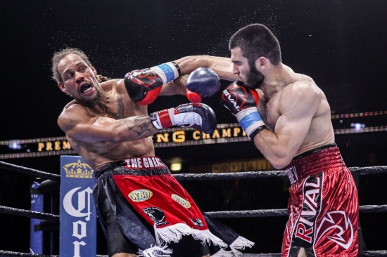 Beterbiev, at right, drives back Johnson wiht a smashing overhand right (photo by  Lucas Noonan/Premier Boxing Champions)