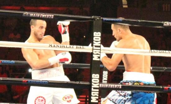 Kovalev, at right, stalks Muhammedi.