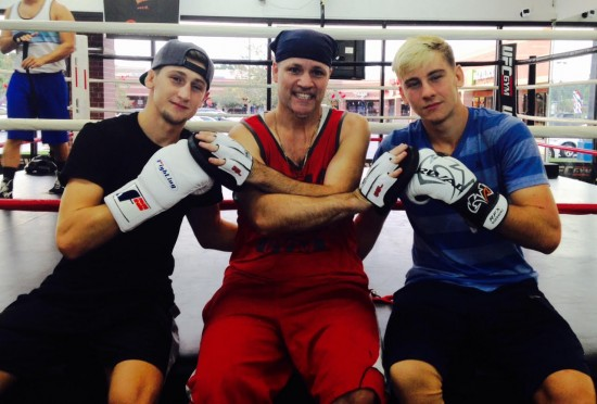 Former light heavyweight contender and current trainer, 'Ice' John Scully, sits between these two young prospects.