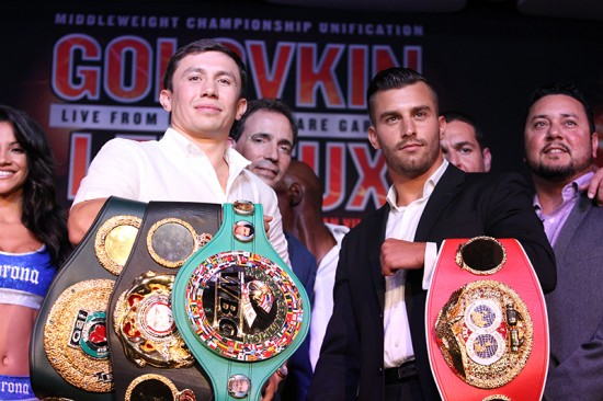 Golovkin, at left, and Lemieux pose for the camera with their title belts (photo by Hogan Photos/K2 Promotions & Golden Boy Promotions)