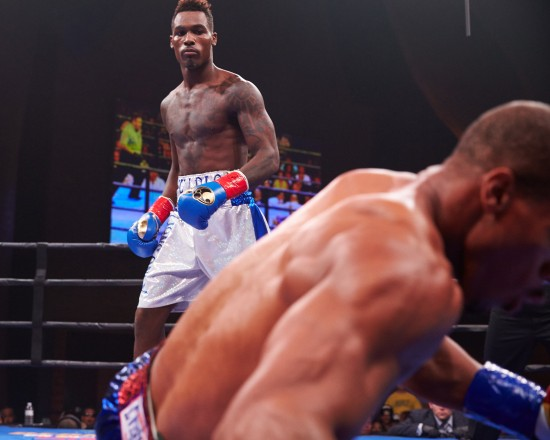 Charlo, at left, looks down on Bundrage, his fallen opponent.